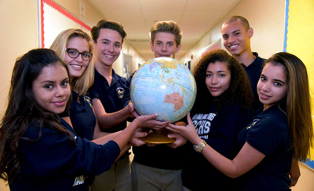 Students holding globe