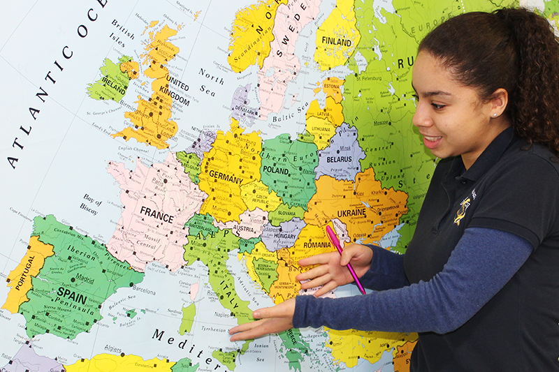 Image of student pointing at map
